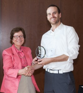 Tyler Lark with University of Wisconsin Chancellor Rebecca Blank, receiving a 2016 Administrative Improvement award for his teaching and advising role in a student-initiated project to reduce campus receipt waste.